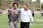 WSU wide receiver, Gabe Marks, and linebackers coach, Ken Wilson, share a light moment before the annual Washington State Cougar spring game, the Crimson and Gray game, at Joe Albi Stadium in Spokane, Washington, on April 23, 2016.