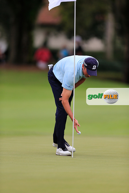 Matt Kucher (USA) holes out on the 1st during round 4 of the Hero World Challenge, Isleworth Golf &amp; Country Club, Windermere, Orlando Florida, USA. 07/12/2014<br /> Picture Fran Caffrey, www.golffile.ie