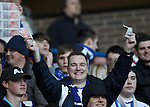 Killie fans waving money at the Rangers support
