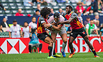 Papua New Guinea vs Tunisia during their HSBC Sevens Wold Series Qualifier match as part of the Cathay Pacific / HSBC Hong Kong Sevens at the Hong Kong Stadium on 27 March 2015 in Hong Kong, China. Photo by Manuel Bruque / Power Sport Images