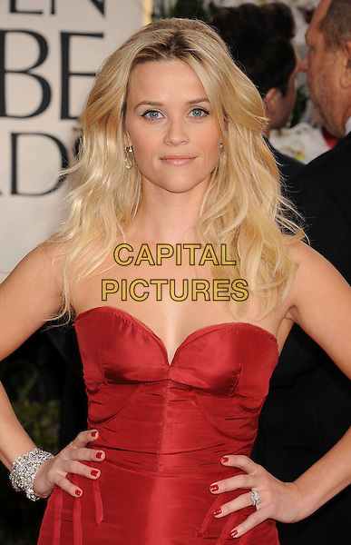 Reese Witherspoon.Arrivals at the 69th Annual Golden Globe Awards at The Beverly Hilton Hotel, Beverly Hills, California, USA..January 15th, 2012.globes half length dress hands on hips nail varnish polish red strapless.CAP/GDG.©GDG/Capital Pictures