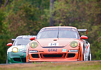 A pair of Porsches races past fall foliage during the Grand-Am Rolex Series test at Virginia International Raceway, Alton, VA , October 2010. (Photo by Brian Cleary/www.bcpix.com)
