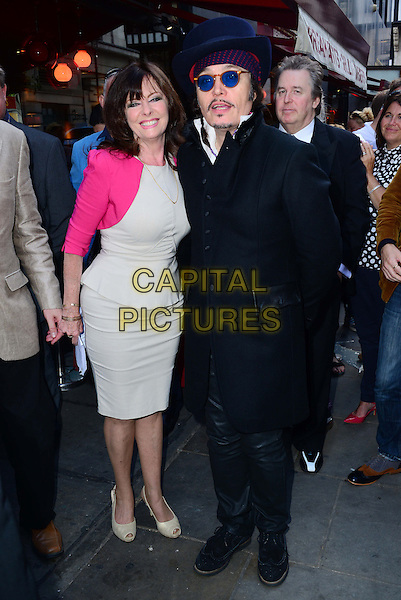 LONDON, ENGLAND - JUNE 29:  Vicki Michelle; Adam Ant  attend Brian Epstein blue plaque unveiling.  Late Beatles manager, Brian Epstein, is honoured with plaque at historic site of his company NEMS former offices, at Sutherland House, 5-6 Argyll Street, on June 29, 2014, in London, England. <br /> CAP/JOR<br /> &copy;Nils Jorgensen/Capital Pictures