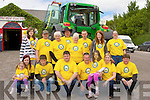 RING REVERSE: Mike and PJ Delaney pictured with their helpers after they reversed their tractors around the Ring of Kerry in aid of the Saoirse foundation on Sunday. Pictured front l-r: Leona Delaney, Roisin O'Sullivan, Timmy Healy, PJ, Mike, Nadine and Collette Delaney, Seamus Kelleher. Back l-r: Ashley Keane, Donal and Josie Kelleher, John and Margaret Delaney, Patrick Dennehy, Regina Harrington and Peggy Delaney..
