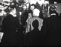 BNPS.co.uk (01202 558833)<br /> Pic: Mullocks/BNPS<br /> <br /> Hitler greets Lloyd George at Wachenfeld House in Berchtesgaden.<br /> <br /> A remarkable film of David Lloyd George's visit to Germany to meet Adolf Hitler in 1936 after which he described him as 'the greatest living German' has emerged for auction.<br /> <br /> The unique black and white 16mm film which lasts 20 minutes shows former Prime Minister Lloyd George and his entourage twice meeting Hitler and driving along newly created autobahns.<br /> <br /> The grainy footage captures Lloyd George with Hitler at a dinner party, him laying a wreath at a war memorial in Munich and the alarming sight of the Nazi and United Kingdom flags hanging together on a German building.<br /> <br /> The film belongs to a British historian with a large collection of archive footage and is tipped to sell for &pound;1,200.