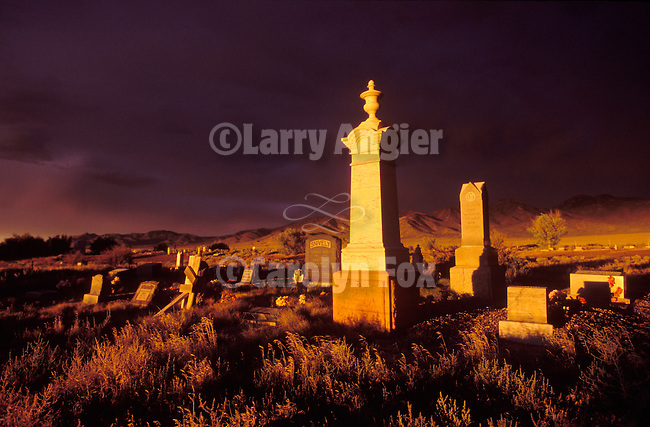 Headstones in cemetery, storm at sundown, Deep Creek Range, Ibapah, Utah.