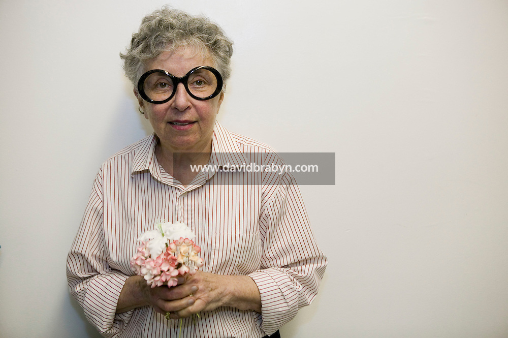 6 April 2006 - New York City, NY - Sylvia Weinstock poses holding edible flowers at Sylvia Weinstock Cakes in New York City, USA, 6 April 2006. The owner, Sylvia Weinstock is known as the queen of wedding cakes in New York.