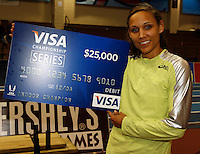 Lolo Jones with her VISA CHAMPIONSHIP SERIES $25,000 Check.Photo by Errol Anderson,The Sporting Image.