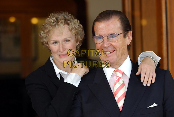 GLENN CLOSE, ROGER MOORE.Photocall for The Night Of 1000 Voices at Royal Albert Hall in aid of the Variety Club Children's Charity..www.capitalpictures.com.sales@capitalpictures.com.©Capital Pictures