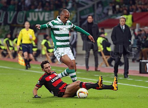 25.02.2016. Leverkusen, Germany. UEFA Europa League football. Bayer Leverkusen versus Sporting Lisbon.   Hakan Calhanoglu (Bayer 04 Leverkusen), Joao Mario (Sporting Lisbon)