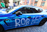 A bright blue Porsche Supercar parked outside London's famous Harrods store in Knightsbridge looks to be vandalised. It is unknown whether it was part of some kind of publicity stunt - as has happened in the past - or whether it was done to vengefully highlight the owner's shameless 'free spending'. The sports car with number plate 'Cash4 Mee' had been daubed with various slogans such as 'Robbed' and 'Fuck You Show Off' with 'Take Off Da Rich Give to da Poor' on the bonnet. Saturday August 24th 2019