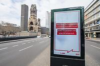 """Die Auswirkungen der Corona-Krise sind nach Inkrafttreten der Anordnung des Berliner Senats, wonach nur noch Versorgungsgeschaefte die fuer den taeglichen Bedarf notwendig sind geoeffnet sein duerfen (Lebensmittelgeschaefte, Apotheken, Drogerien, Zeitungsgeschaefte), im oeffentlichen Leben deutlich sichtbar.<br /> Im Bild: Eine Werbetafel mit einer Oeffentlichkeitskampagne des Berliner Senat, mit der die Bevoelkerung u.a. aufgerufen wird, """"soziale Kontakte auf ein Minimum"""" zu reduzieren um gemeinsam gegen die Verbeitung des Corona-Virus zu kaempfen. Im Hintergrund die geschlossene Kaiser Wilhelm-Gedaechtniskirche.<br /> 19.3.2020, Berlin<br /> Copyright: Christian-Ditsch.de<br /> [NUR FUER REDAKTIONELLE ZWECKE! Werbung nur auf Anfrage beim Fotografen. Inhaltsveraendernde Manipulation des Fotos nur nach ausdruecklicher Genehmigung des Fotografen. Vereinbarungen ueber Abtretung von Persoenlichkeitsrechten/Model Release der abgebildeten Person/Personen liegen nicht vor. NO MODEL RELEASE! Don't publish without copyright Christian-Ditsch.de, Veroeffentlichung nur mit Fotografennennung, sowie gegen Honorar, MwSt. und Beleg. Konto: I N G - D i B a, IBAN DE58500105175400192269, BIC INGDDEFFXXX, Kontakt: post@christian-ditsch.de<br /> Bei der Bearbeitung der Dateiinformationen darf die Urheberkennzeichnung in den EXIF- und  IPTC-Daten nicht entfernt werden, diese sind in digitalen Medien nach §95c UrhG rechtlich geschuetzt. Der Urhebervermerk wird gemaess §13 UrhG verlangt.]"""