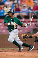 Jose De Los Santos of the Lynchburg Hillcats follows through on his swing versus the Winston-Salem Dash at Wake Forest Baseball Stadium August 30, 2009 in Winston-Salem, North Carolina. (Photo by Brian Westerholt / Four Seam Images)