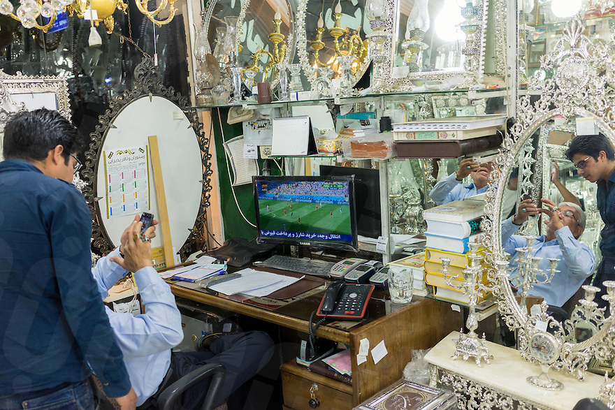 June 21, 2014 - Yazd (Iran). A shop owner watches the Iranian team playing against Argentina during the 2014 World Cup. © Thomas Cristofoletti / Ruom