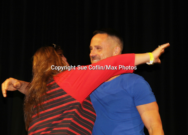 General Hospital's actor William DeVry greets a fan on October 5, 2019 at the Hollywood Casino, Columbus, Ohio with a Q & A and a VIP meet and greet. (Photo by Sue Coflin/Max Photo)