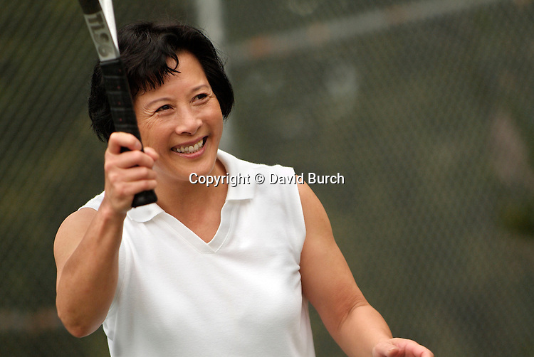 Asian woman playing tennis