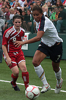 USWNT's Shannon Boxx (7), rt and Canada's Diana Matheson go after the ball. The U.S. Women's National Team defeated Canada 1-0 in a friendly match at Marina Auto Stadium in Rochester, NY on July 19, 2009..
