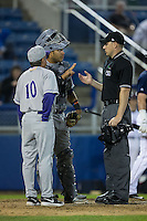 Winston-Salem Dash catcher Omar Narvaez (22) and manager Tim Esmay (10) discuss a call with home plate umpire Skyler Shown during the game against the Salem Red Sox at LewisGale Field at Salem Memorial Ballpark on May 13, 2015 in Salem, Virginia.  The Red Sox defeated the Dash 8-2.  (Brian Westerholt/Four Seam Images)