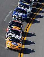 Apr 26, 2009; Talladega, AL, USA; NASCAR Sprint Cup Series driver Kykle Busch (18) leads the field during the Aarons 499 at Talladega Superspeedway. Mandatory Credit: Mark J. Rebilas-