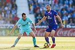 Nourredine Amrabat of CD Leganes (R) fights for the ball with Sergio Busquets Burgos of FC Barcelona (L) during the La Liga 2017-18 match between CD Leganes vs FC Barcelona at Estadio Municipal Butarque on November 18 2017 in Leganes, Spain. Photo by Diego Gonzalez / Power Sport Images