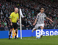 Gary Teale takes a corner watches by Assistant Referee Martin Cryans in the St Mirren v Celtic Scottish Communities League Cup Semi Final match played at Hampden Park, Glasgow on 27.1.13.
