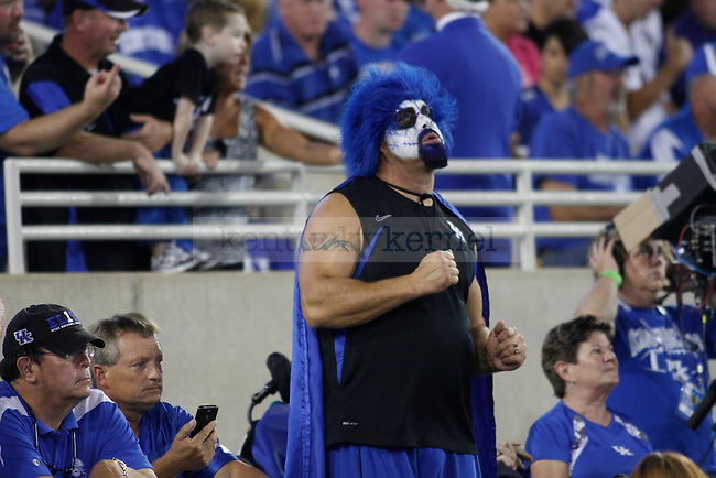 A fan dances during the first half of the UK football game against Florida at Commonwealth Stadium in Lexington, Ky., on Saturday, September 28, 2013. Photo by Eleanor Hasken | Staff