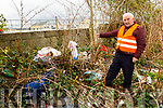 Cllr: Charlie Farrelly at the site of the illegal dumping on the laneway near the Mart in Castleisland town.