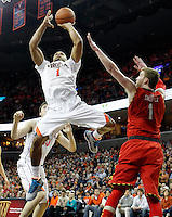 Virginia guard Justin Anderson (1) shoots next to Maryland forward Evan Smotrycz (1) during the game Monday night in Charlottesville, VA. Photo/The Daily Progress/Andrew Shurtleff