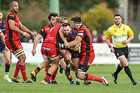 Ed Hoadley of London Scottish looks for a way through during the Greene King IPA Championship match between London Scottish Football Club and Hartpury RFC at Richmond Athletic Ground, Richmond, United Kingdom on 28 October 2017. Photo by David Horn.