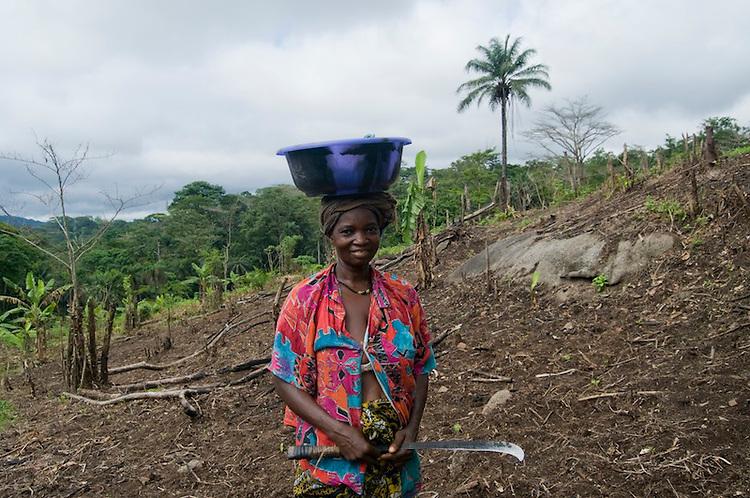 Woman working in a field near the village of Sengema, Kailahun District. Sierra Leone. Photo taken May 1. 2010.