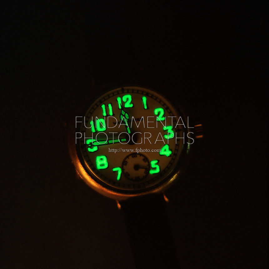 RADIUM: LUMINOUS (GLOW-IN-THE-DARK) WATCH (2 of 2)<br /> Phosphorescence A Form Of Luminescence<br /> (Viewed in Darkness) The hands &amp; numbers contain minute amounts of radium salt. The radioactive decay of radium causes the watch to glow in the dark. Phosphorescence is luminescence which continues after the radiation causing it ceases.