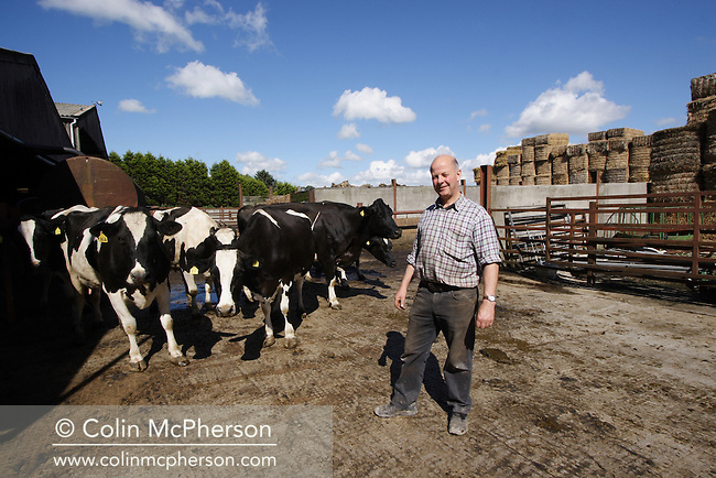 Dairy farmer Eddie Cowpe, pictured at his family business, Huntley Gate farm close to the village of Samesbury, near Clitheroe, Lancashire in north west England with a herd of milking cattle. Mr Cowpe's family has farmed this land since 1208AD and since the 2001 foot and mouth epidemic has diversified the farm to include a shop, bakery, antique shop and butchery.