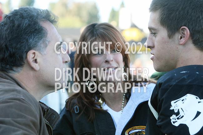 Palos Verdes, CA 10/30/09 - Ridge Abraham (#1) speaks with Tom Papadakis regarding his injury at half time, with Christy Abraham looking on.