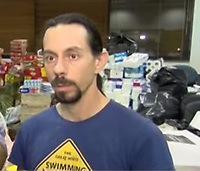 Pictured: Giannis Filippopoulos, the father of the two missing girls.<br /> Re: Two twin sisters Sofia and Vassiliki Filippopoulou who couldn't be located by their parents after the wild forest fire in the Mati area of Rafina in Greece, have seen them on live tv,<br /> Their father Giannis Filippopoulos has described how he and his wife were frantically searching for them and even went to the morgue to be DNA swabbed without success. They then saw their two twin daughters being transferred by boat to safety but claim their names were not recorded. They had gone to the area with their grandparents Filippos and Sofia for their summer holiday.