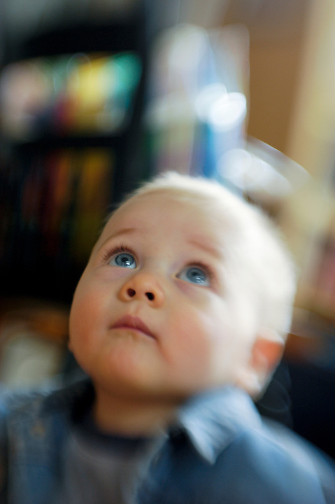 Nine-month-old Liam Byrne looks up in wonder during a visit at his grandparents Ivan and Robbie Preston's house in Madison, Wis., on July 3, 2005. The photograph was made using a selective-focus lens.