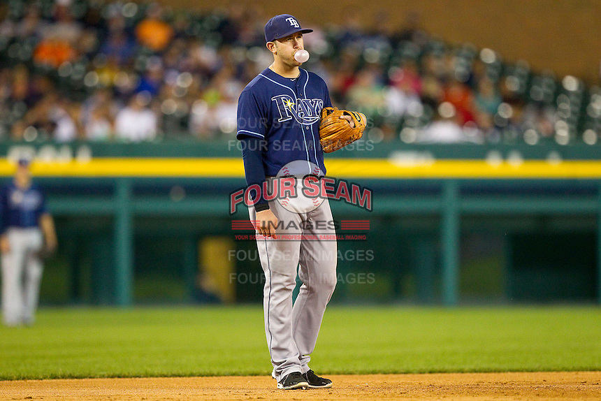 Tampa Bay Rays third baseman Evan Longoria (3) blows a bubble during the Major League Baseball game against the Detroit Tigers at Comerica Park on June 4, 2013 in Detroit, Michigan.  The Tigers defeated the Rays 10-1.  Brian Westerholt/Four Seam Images