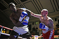 John Harding Jr (white/black shorts) defeats Lewis Van Poetsch during a Boxing Show at York Hall on 10th February 2018