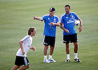 Coach, Carlo Ancelotti, speaks with his assistant during Real Madrid´s first training session of 2013-14 seson. July 15, 2013. (ALTERPHOTOS/Victor Blanco) ©NortePhoto