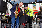 Dave Rath with Amy Lynch from Tralee and Gda Mary Gardiner singing at the annual Christmas Garda music and street collection in the Mall on Monday.