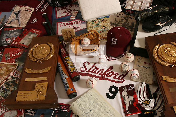 1 December 2005: Baseball cover shoot for the media guide. Memorabilia featuring cap, uniform, NCAA Championship trophy, baseball glove, baseballs, media guides and more.