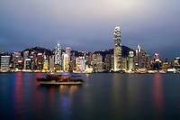Beautiful new night photograph of the fabulous famous Hong Kong skyline with Victoris peak in background and all the tall skyscrapers lit at nigh