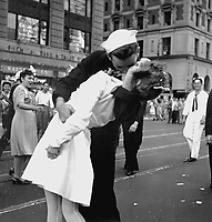 New York City celebrating the surrender of Japan. They threw anything and kissed anybody in Times Square. August 14, 1945. Lt. Victor Jorgensen. (Navy)