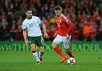 Wales Aaron Ramsey is put under pressure from Ireland's Robbie Brady<br /> <br /> Photographer Ian Cook/CameraSport<br /> <br /> FIFA World Cup Qualifying - European Region - Group D - Wales v Republic of Ireland - Monday 9th October 2017 - Cardiff City Stadium - Cardiff<br /> <br /> World Copyright &copy; 2017 CameraSport. All rights reserved. 43 Linden Ave. Countesthorpe. Leicester. England. LE8 5PG - Tel: +44 (0) 116 277 4147 - admin@camerasport.com - www.camerasport.com