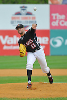 Pitcher Sean Gilmartin (11) of the New Britain Rock Cats delivers a pitch during a game against the Portland Sea Dogs at New Britain Stadium on May 15, 2014 in New Britain, Connecticut. Portland defeated New Britain 13-5.  (Gregory Vasil/Four Seam Images)