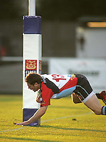 Harlequins centre Darren Cave crosses below the posts to score during the First Trust Senior Cup Final at Ravenhill. Result - Dungannon 27pts Harlequins 10pts.
