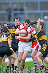 John Buckley Rathmore is surrounded by Currow defenders Pat O'Sullivan, Daniel O'Shea and Seamus Flynn during their O'Donoghue cup semi final in Fitzgerald Stadium on Sunday