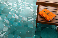 Bismarck Grand, a hand-cut stone mosaic, shown in honed and polished Aloe Basalto, is part of the Bright Young Things™ collection by New Ravenna.
