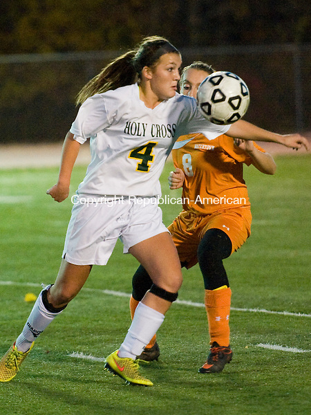WOLCOTT, CT-27 October 2014-102714EC06--   Holy Cross' Julia Sheetz tries to control the ball with pressure from Watertown's Gabriella Traver Monday night in Wolcott. The Crusaders lost to the Indians, 2-0. Erin Covey Republican-American