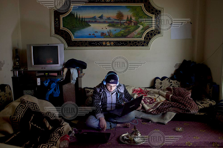 Activist at work in a media center in Bab Amr, Homs a few hours before it was shelled