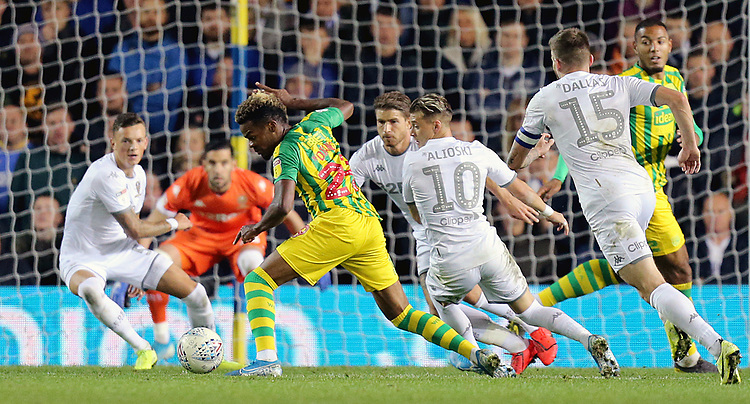 West Bromwich Albion's Grady Diangana looks to get away from Leeds United's Ezgjan Alioski<br /> <br /> Photographer Rich Linley/CameraSport<br /> <br /> The EFL Sky Bet Championship - Tuesday 1st October 2019  - Leeds United v West Bromwich Albion - Elland Road - Leeds<br /> <br /> World Copyright © 2019 CameraSport. All rights reserved. 43 Linden Ave. Countesthorpe. Leicester. England. LE8 5PG - Tel: +44 (0) 116 277 4147 - admin@camerasport.com - www.camerasport.com